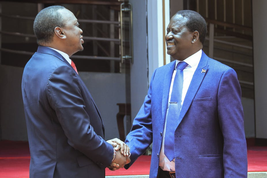 President Uhuru Kenyatta Shaking hands with Orange Democratic (ODM) leader Raila Odinga