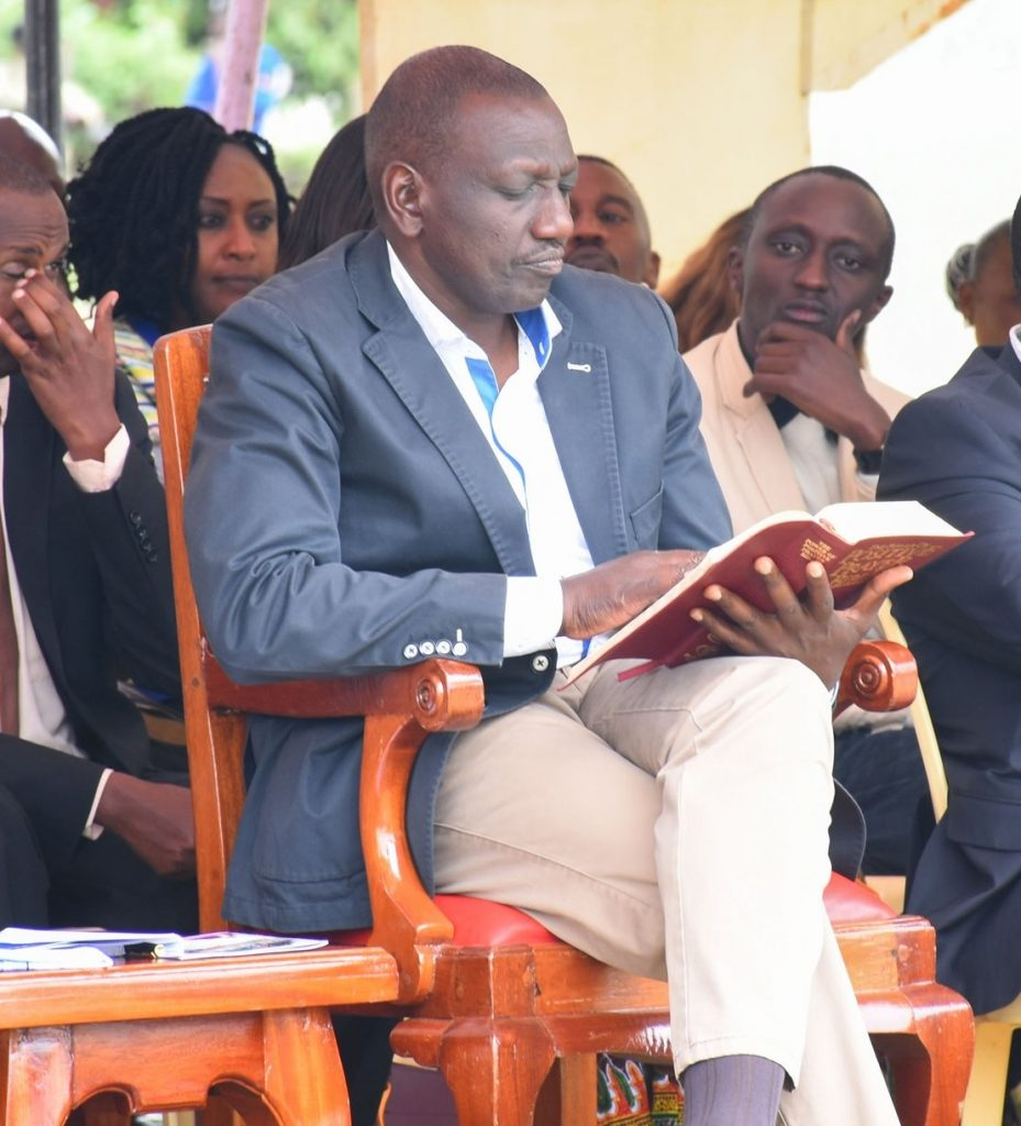 William Ruto Reading a Bible in Church