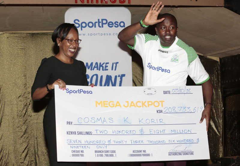 Cosmas Korir Showing His Huge SportPesa Win of Ksh. 208 million