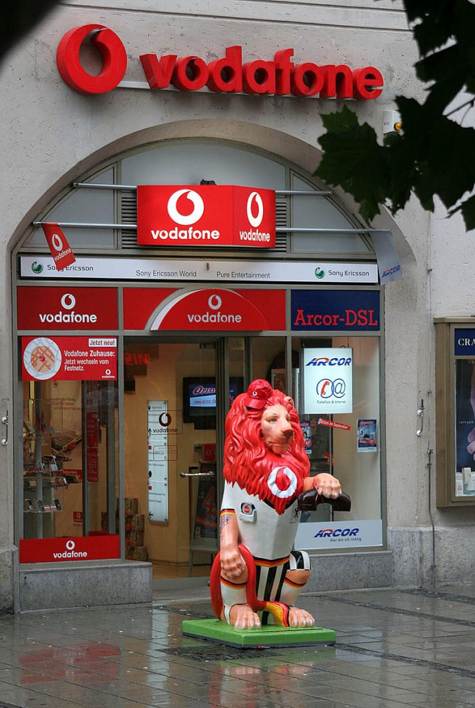 A Vodafone shop in Germany. Central Bank of Kenya extended the Mpesa rates until end of December 2020. Mpesa is a subsidiary of Vodafone Group Plc