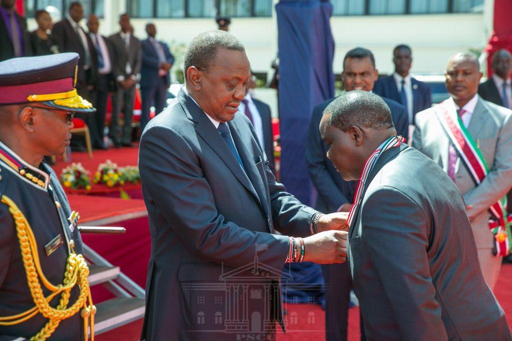 Fred Matiangi and Uhuru Kenyatta.