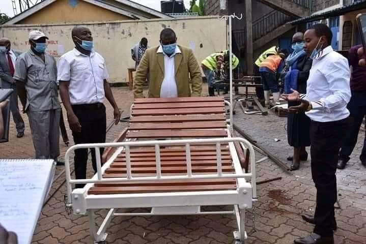 Mungai Gathongo and  Joseph Mhinja present their prototype Hospital bed to the Presidential Delivery team who were ordered by Mr. Uhuru Kenyatta to place an order for 500 beds.