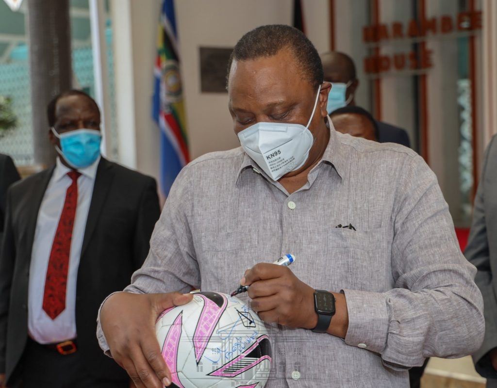 President Uhuru Kenyatta signing a ball. It has emerged that Kikuyu men are the most abused men in the whole country.